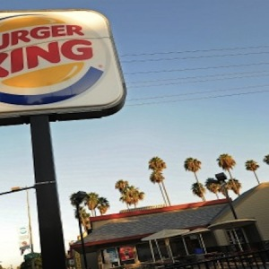A Burger King sign outside a restaurant